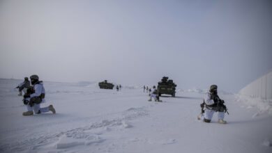 US Soldiers assigned to 3rd Battalion, 21st Infantry Regiment provide overwatch during an arctic deployment of Stryker armored vehicles as part of the US Army Alaska led exercise Arctic Edge 18 at Eleison Air Force Base, Alaska, March 13, 2018.