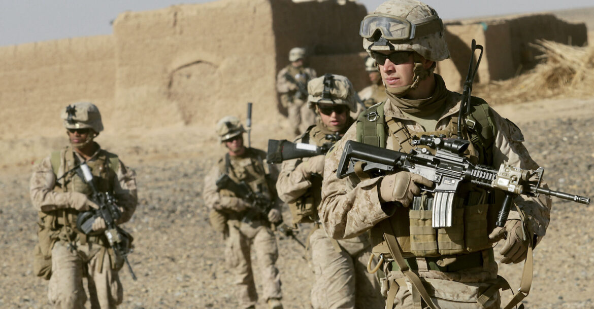 US Marine Sgt. Bryan Early, a squad leader with 1st Battalion, 9th Marine Regiment, leads his squad of Marines to the next compound while patrolling in Helmand province, Afghanistan