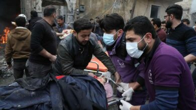 Rescue workers carry away a victim at the scene of an explosion in the town of Azaz in the rebel-controlled northern countryside of Syria's Aleppo province, January 31, 2021.