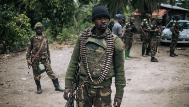 A Democratic Republic of Congo soldier is seen on patrol in the village of Manzalaho, near Beni, Feb. 18, 2020, following an alleged attack by members of the Allied Democratic Forces (ADF) rebel group.