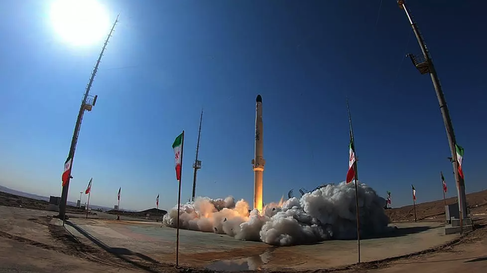 """A handout picture provided by Iran's Defence Ministry shows the launch of Iran's newest satellite-carrying rocket, called """"Zuljanah,"""" at an undisclosed location on February 1, 2021."""