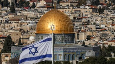 An Israeli flag flies in Jerusalem on 27 January, 2020.