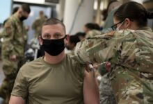 In a handout photo taken on December 29, 2020 by US Forces Korea, a service member of the United States Forces Korea receives the first round of the Moderna vaccine at Osan Air Base, south of Seoul