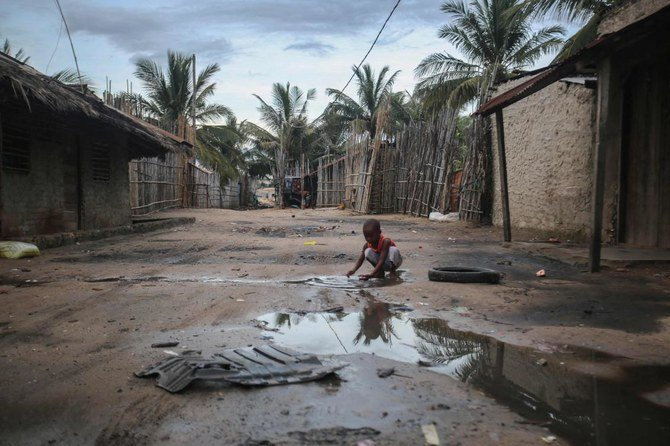 A child plays in an alley at the Port of Paquitequete near Pemba, March 29, 2021, where sailing boats are expected to arrive with people displaced from the coasts of Palma and Afung