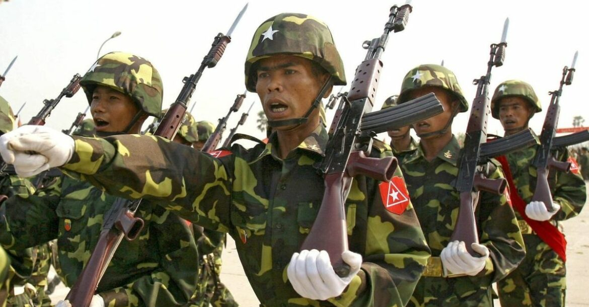 Myanmar soldiers seen marching in formation.