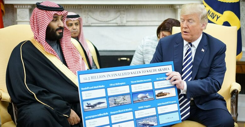 US President Donald Trump holds a defense sales chart with Saudi Arabia's Crown Prince Mohammed bin Salman in the Oval Office of the White House on March 20, 2018 in Washington, DC