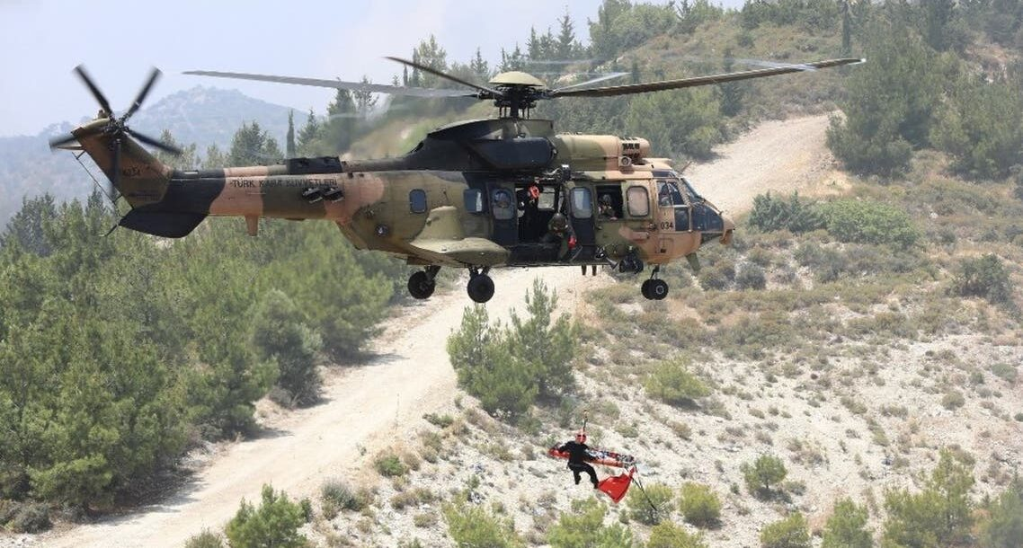 A Turkish army's Eurocopter AS532 Cougar helicopter takes part in a military rescue mission exercise in the northern part of the Mediterranean island of Cyprus in the self-proclaimed Turkish Republic of Northern Cyprus, on June 11, 2019