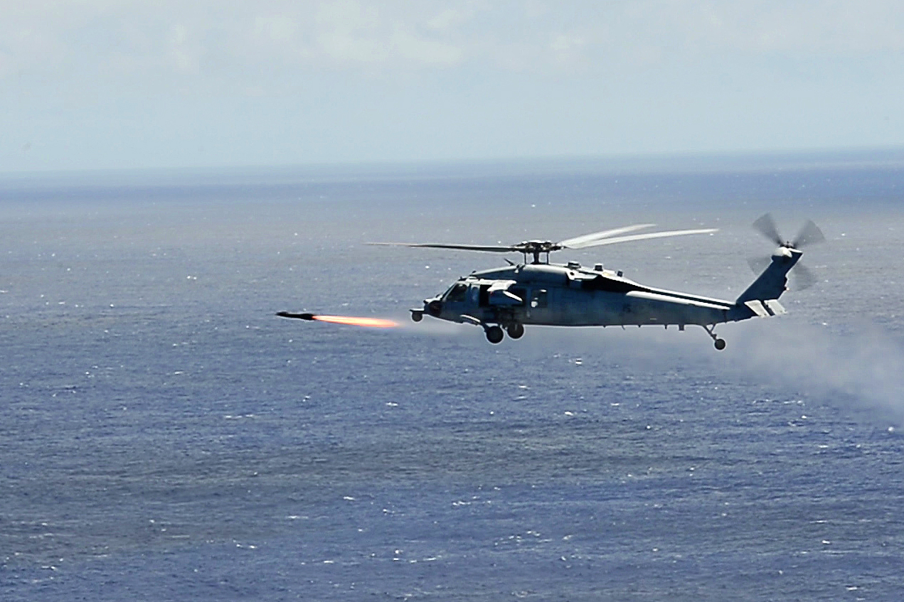 Helicopter fires AGM-114 Hellfire II missile during RIMPAC