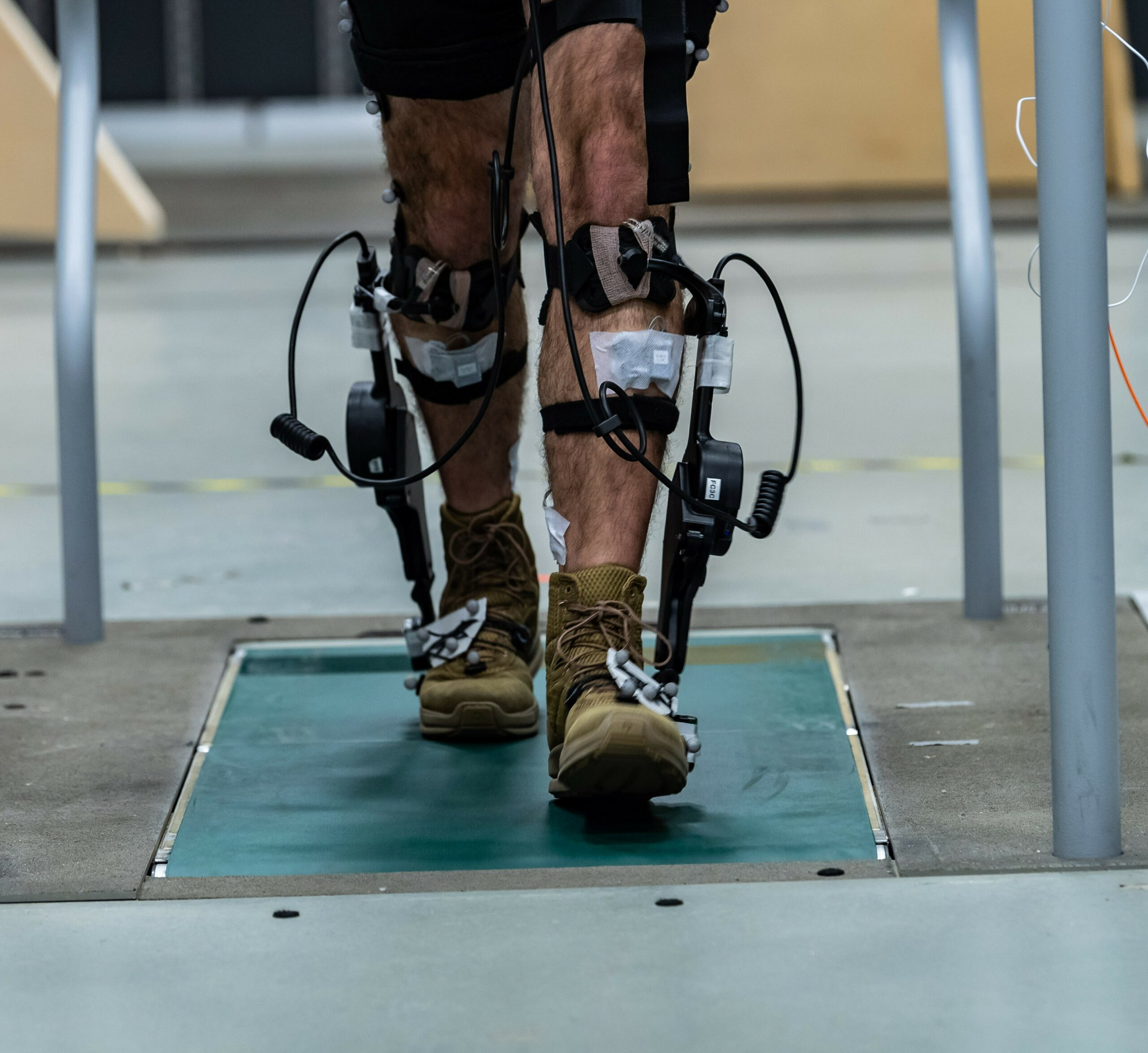 autonomous tech attached to the feet and legs of test subject