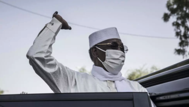 Chadian President Idriss Deby Itno greets supporters as he leaves after casting his ballot at a polling station in N'djamena on April 11, 2021.