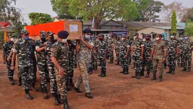 Members of Indian security forces carry the coffin of one of their colleagues, who died following a battle with Maoist rebels in India's Chhattisgarh state, on April 4