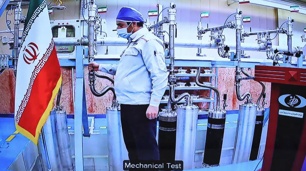 A handout picture provided by the Iranian presidential office on Saturday shows a video conference screen of an engineer inside Iran's Natanz uranium enrichment plant