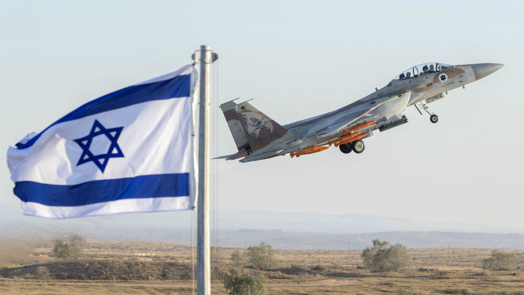 An Israeli Air Force F-15 Eagle fighter plane performs at an air show during the graduation of new cadet pilots at Hatzerim base in the Negev desert, on June 29, 2017