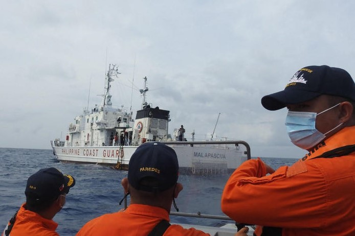 In this undated handout photo received from the Philippine Coast Guard in April, coast guard personnel conduct maritime exercises near Thitu island in the disputed South China Sea