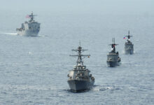 The Arleigh Burke-class destroyer USS John S. McCain (DDG 56), the Philippine navy frigate BRP Gregaorio del Pilar (PF-15), the Philippine navy frigate BRP Ramon Alcaraz (PF-16) and the Whidbey Island-class amphibious dock landing ship USS Ashland (LSD 48) steam in formation during Cooperation Afloat Readiness and Training (CARAT) Philippines 2014.