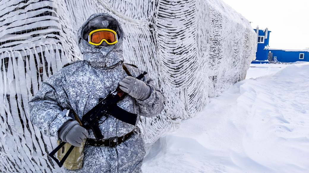 A soldier holds a machine gun as he patrols the Russian northern military base on Kotelny island, beyond the Artic Circle, on April 3, 2019.