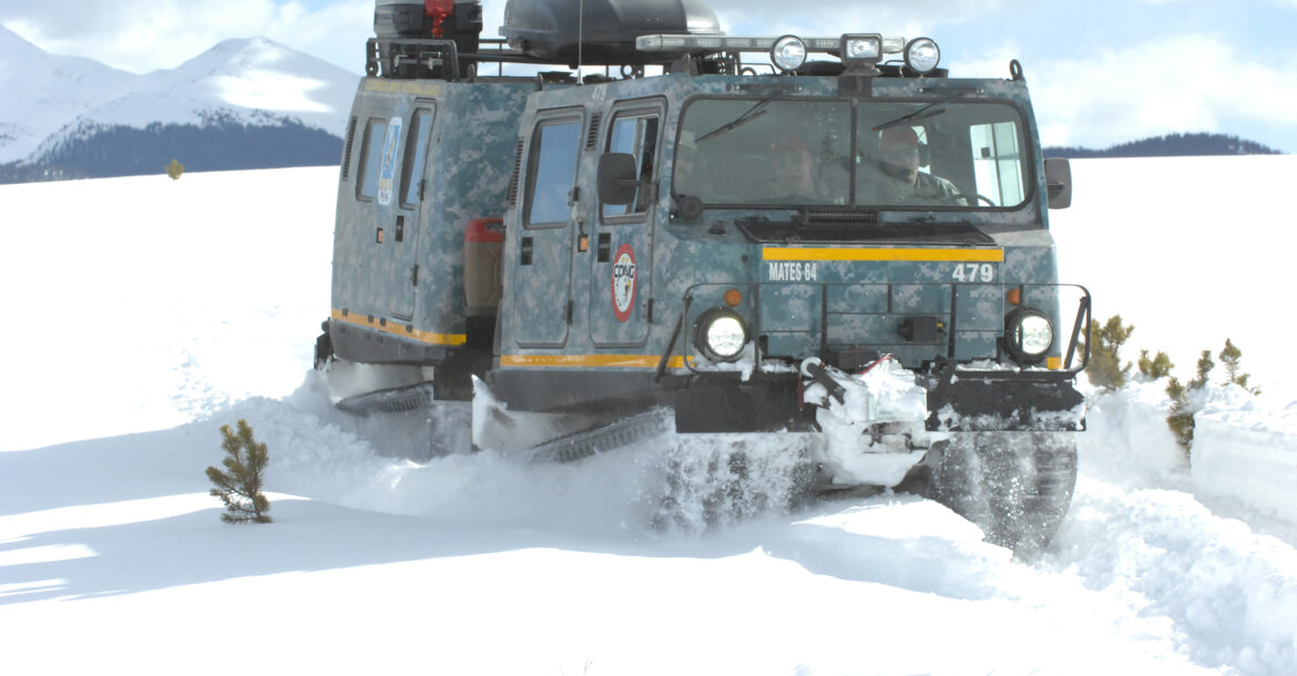 An M973A1 Small Unit Support Vehicle (SUSV) clad in emergency lights and digital camouflage, claws its way through the snow at Taylor Park Reservoir near Gunnison, Colo., March 15, 2010