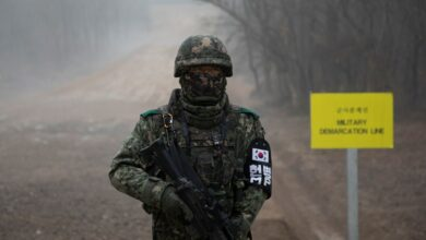 A South Korean soldier stands before the military demarcation line separating North and South Korea