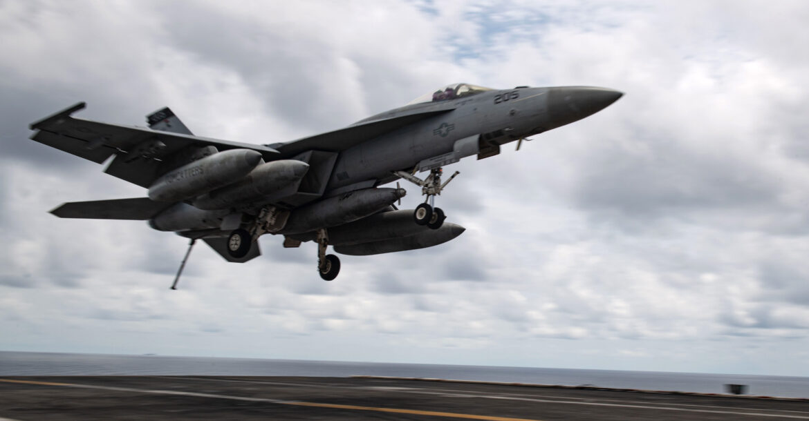 """An F/A-18E Super Hornet, assigned to the """"Tomcatters"""" of Strike Fighter Squadron (VFA) 31, approaches the flight deck of the aircraft carrier USS Theodore Roosevelt (CVN 71) April 5, 2021"""