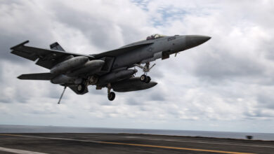 "An F/A-18E Super Hornet, assigned to the ""Tomcatters"" of Strike Fighter Squadron (VFA) 31, approaches the flight deck of the aircraft carrier USS Theodore Roosevelt (CVN 71) April 5, 2021"