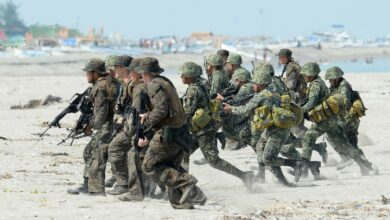 The Philippine and US Marines taking positions during a beach assault exercise facing the South China Sea in San Antonio, Zambales province on May 9, 2014