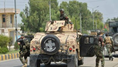 Afghan soldiers arrive in a Humvee vehicle outside a prison during a raid in Jalalabad, Afghanistan, Augustus 3, 2020.