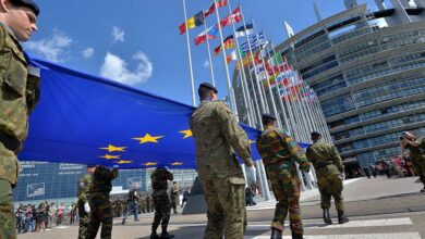 Military carrying European Union flag