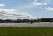 An MQ-9 Reaper with three Ghost Reaper pods attached awaits takeoff at Hancock Field Air National Guard Base, Syracuse, New York.