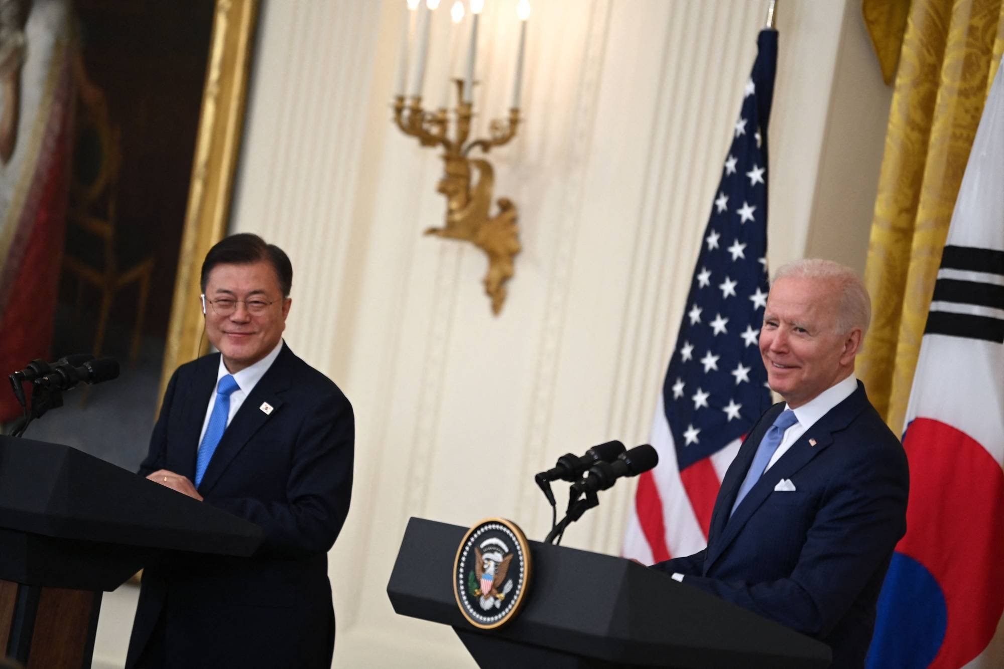 US President Joe Biden (right) and South Korean President Moon Jae-in participate in a press conference in the State Dining Room of the White House in Washington, DC on May 21, 2021