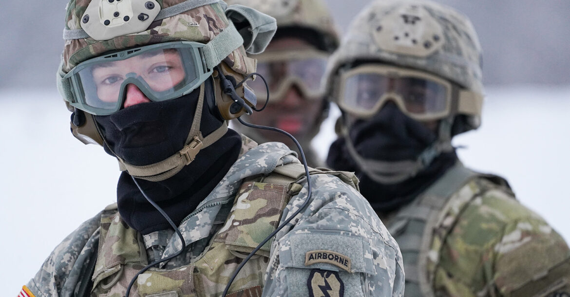 Spc. Eric Stidham assigned to Headquarters and Headquarters Company, 6th Brigade Engineer Battalion (Airborne), 4th Infantry Brigade Combat Team (Airborne), 25th Infantry Division, US Army Alaska, trains with fellow Soldiers and aviators from the Alaska Army National Guard at Neibhur Drop Zone, Nov. 26, 2019