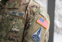 Space Force Staff Sgt. David Diehl II, 436th Communications Squadron noncommissioned officer in charge of wing cybersecurity, displays his new uniform Space Force tapes and service branch patch at Dover Air Force Base, Del., Feb. 12, 2021.