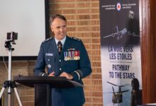 canada air force commander al meinzinger standing during a speech