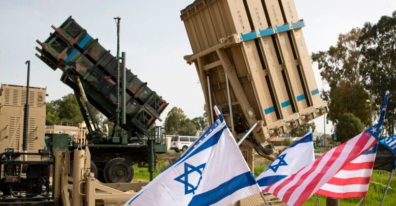 An Israeli Iron Dome anti-rocket system, right, and an American Patriot missile defense system are shown during a joint U.S.-Israel military exercise on March 8, 2018.