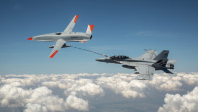 The Boeing MQ-25 T1 test asset transfers fuel to a US Navy F/A-18 Super Hornet on June 4, marking the first time in history that an unmanned aircraft has refueled another aircraft.