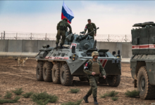 Russian troops with military vehicles are seen on patrol outside the town of Darbasiyah in Syria's northeastern Hasakeh province, on the border with Turkey, Novemer 1, 2019