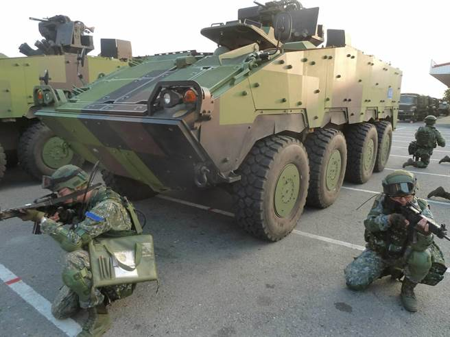 Taiwanese soldiers seen kneeling down beside armored vehicles dubbed the Clouded Leopards. Photo: Army Command Headquarters