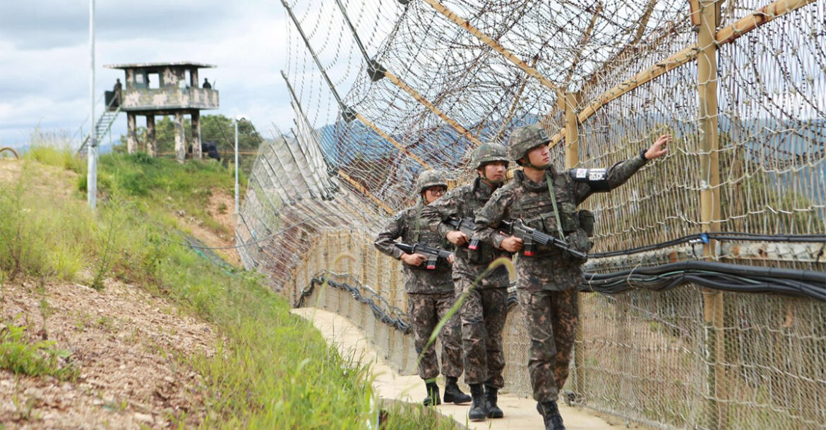 South Korean soldiers patrol along the line through the Demilitarized Zone in Hwacheon County