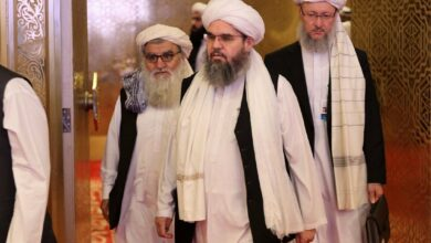 Members of the Taliban delegation arrive for peace talks between the Afghan government and the Taliban in Doha, Qatar on Sunday