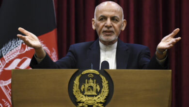 Afghan President Ashraf Ghani gestures as he speaks during a press conference at the presidential palace in Kabul on March 1, 2020