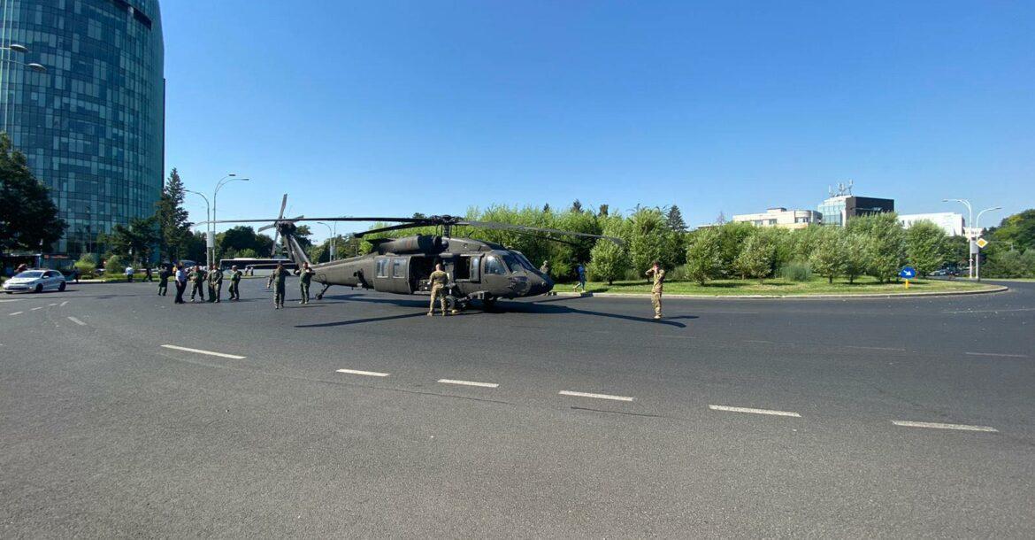 A military Black Hawk helicopter made an emergency landing in busy boulevard in the Charles de Gaulle Square in northern Bucharest on Thursday July 15, 2021 morning, stopping traffic and knocking down two light poles but no injuries were reported
