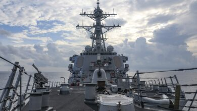 The Arleigh Burke-class guided-missile destroyer USS Benfold (DDG 65) sails through the South China Sea while conducting routine underway operations