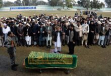 Afghan officials and mourners perform funeral prayers over the coffin of Angiza Shinwari, a provincial member, in Jalalabad