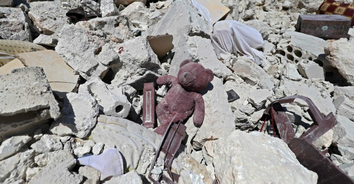 A child's teddy bear is pictured amidst the rubble of a house, following reported shelling by regime forces, in the village of Serja, in the southern part of Syria's Idlib province