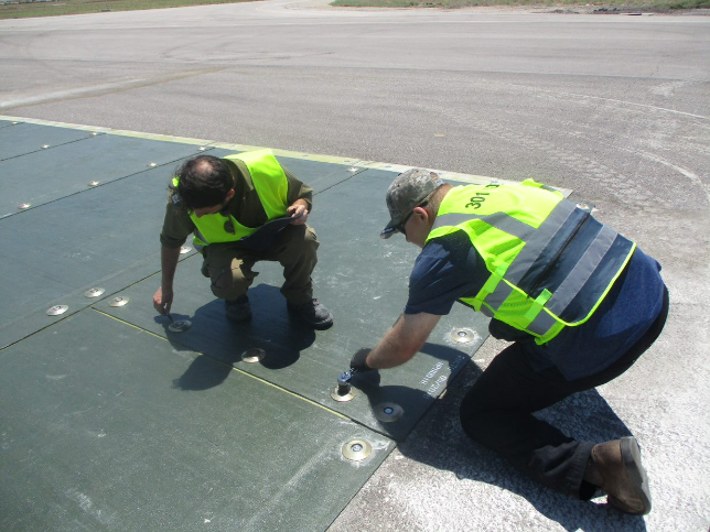 US and Israeli engineers repair a crater using Fiber Reinforced Polymer, or FRP, mats and anchoring systems.