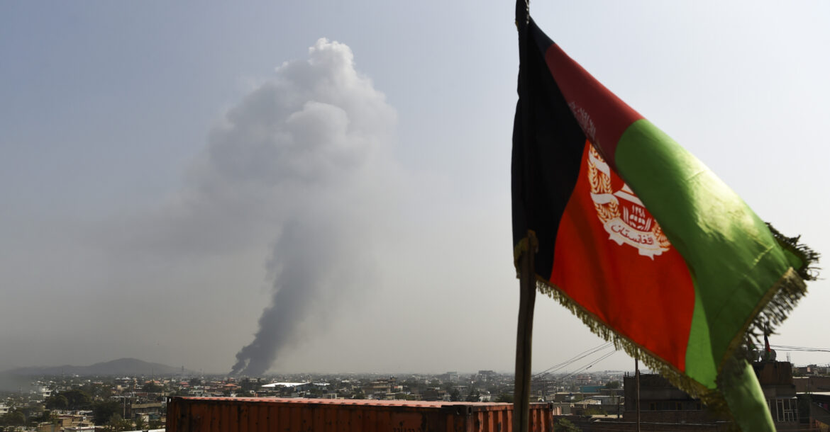 Smoke rises from the site of an attack after a massive explosion the night before near the Green Village in Kabul