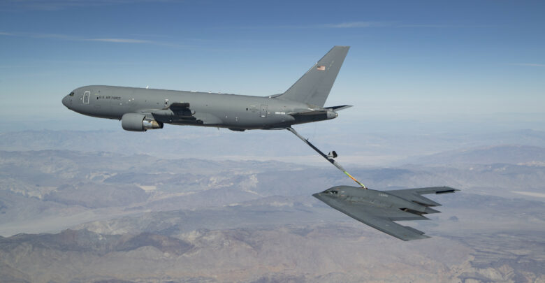 A KC-46 refuels the B-2 for the first time during developmental flight test over Edwards AFB and the Sierra Nevada Mountains in April 2019.