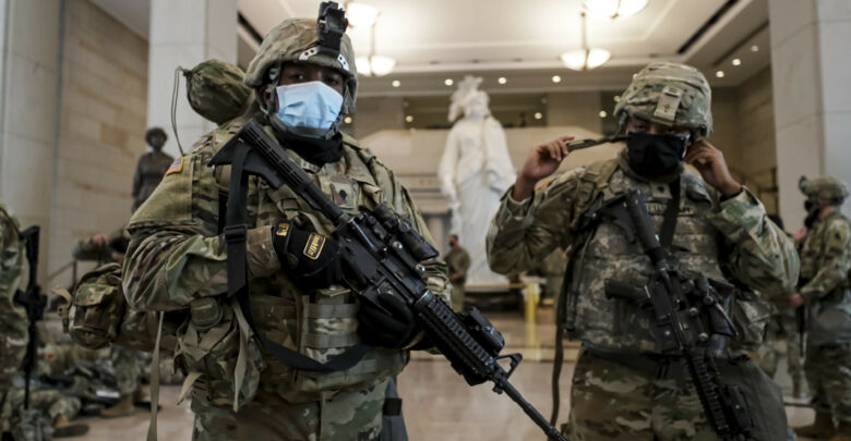 Virginia National Guard Soldiers prepare their gear for after resting in the Visitor Center in the US Capitol in Washington, DC, January 2021