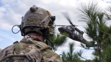 A US Navy SEAL team member awaits extraction from a UH-60 Black Hawk helicopter during an 2019 exercise