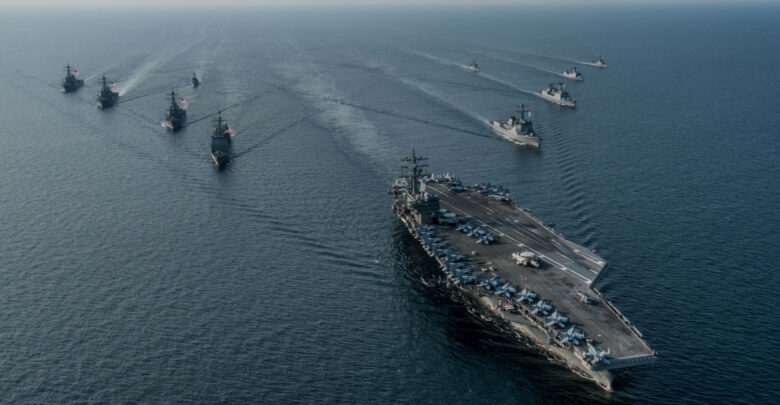 The US Navy's only forward-deployed aircraft carrier, USS Ronald Reagan (CVN 76), steams in formation with ships from Carrier Strike Group Five (CSG 5) and the Republic of Korea Navy (ROKN) during Exercise Invincible Spirit.
