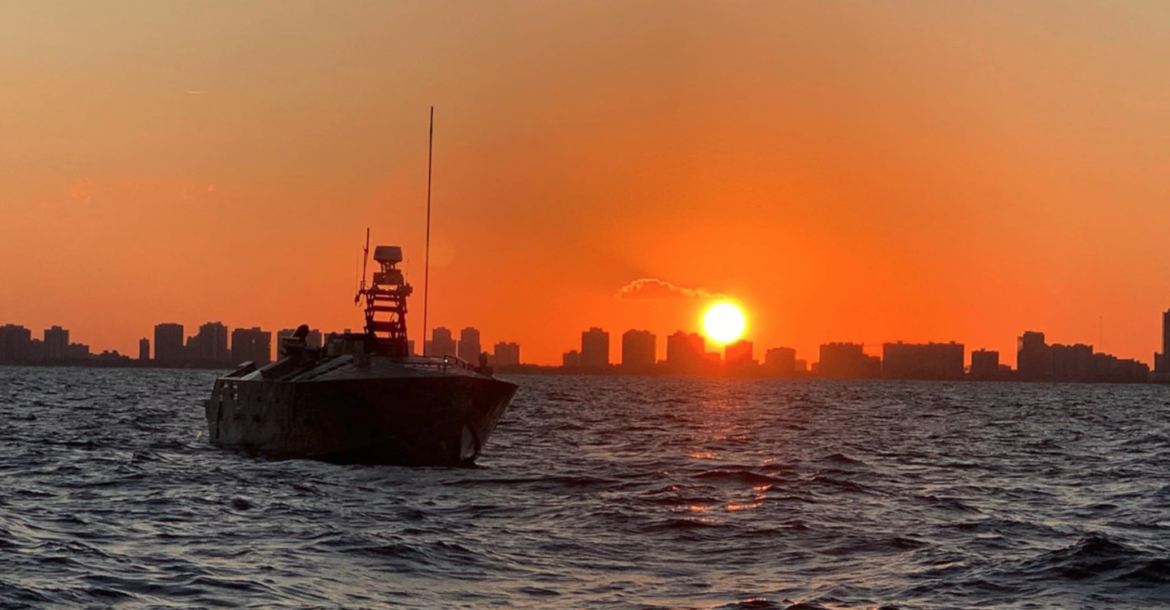 The Unmanned Influence Sweep System (UISS) heads offshore at sunrise for an Operational Assessment mission off the coast of South Florida in November 2019
